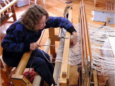 Weaving on Farm Museum Loom